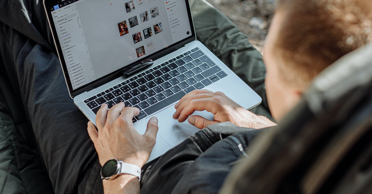 A man sitting in front of a laptop computer