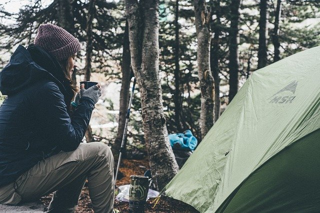 A person sitting in a tent